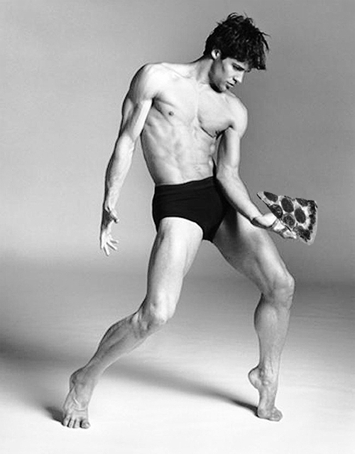reaching for pizza - roberto bolle